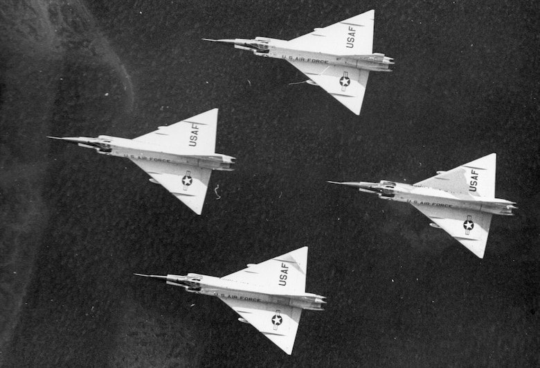 Shadows play across the delta wings and fuselages of a flight of Oregon ANG F-102 Delta Dagger fighter-interceptors, circa 1968.  (142nd Fighter Wing History Archives)