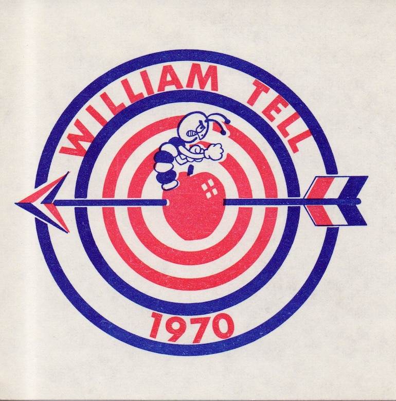 An angry worm shakes his fists at the apple-piercing archer in the William Tell 1970 emblem, which can also be seen in the form of William Tell patches on the F-102 pilot flight suits.  (142nd Fighter Wing History Archives)