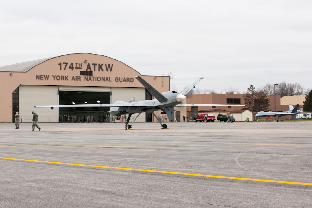 Maintainers from the 174th Attack Wing recover an MQ-9 Reaper, Remotely Piloted Aircraft (RPA), at Hancock Field Air National Guard Base December 16. The MQ-9 was the first to take off at the international airport after the Federal Aviation Administration (FAA) approved the 174th to take off and land from this location earlier in the month. (U.S. Air National Guard photo by Tech. Sgt. Jeremy M. Call/Released)