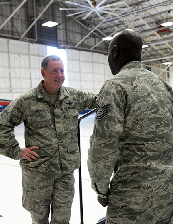 Maj. Gen. James Hecker, 19th Air Force commander, talks to Tech. Sgt. Kevin Fairman, a member of the 149th Fighter Wing, after an all call held Dec. 10 in a maintenance hangar at Joint Base San Antonio-Lackland, Texas.