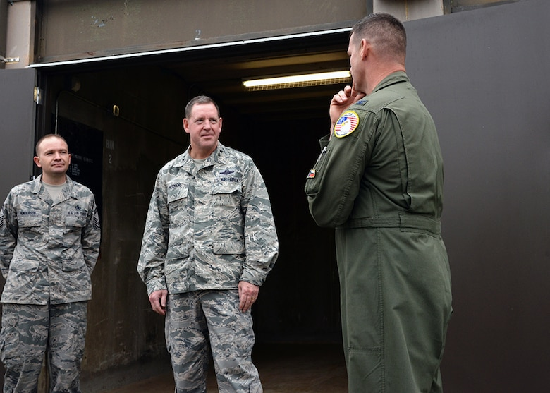 Maj. Gen. James Hecker, 19th Air Force commander, talks to Col. Bradly Glenn, Air National Guard advisor to Air Education Training Command, and Senior Master Sgt. Toby Henderson, the 149th Fighter Wing's munitions flight chief, Dec. 10, during his visit to Joint Base San Antonio-Lackland, Texas.