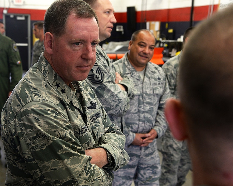 Maj. Gen. James Hecker, 19th Air Force commander, listens to Senior Master Sgt. Toby Henderson, the munitions flight chief for the 149th Fighter Wing, talk about location limitations during his visit Dec. 10 to Joint Base San Antonio-Lackland, Texas. The general took time to stop by several base units and listen to various members brief the commander about their work section.