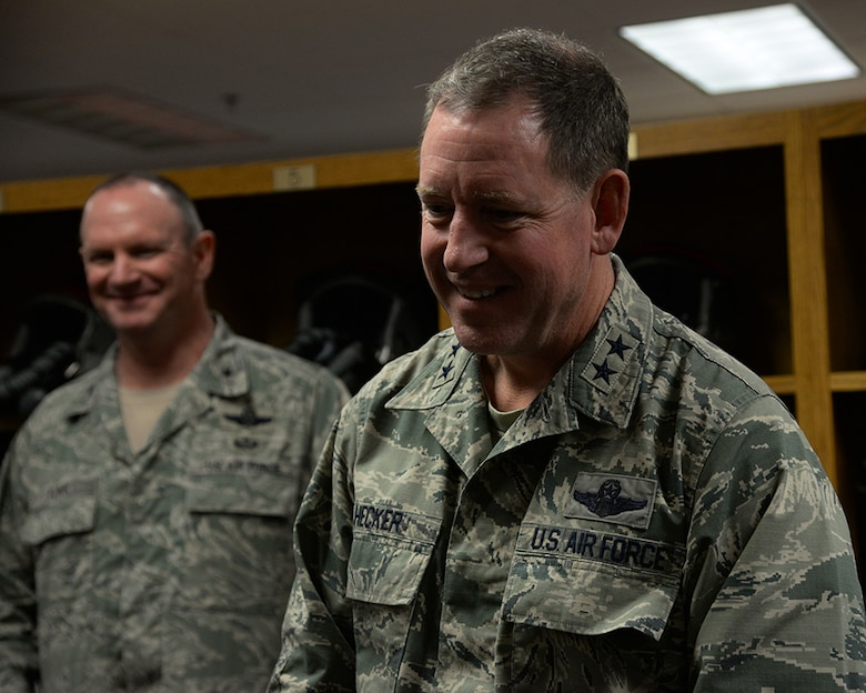 Maj. Gen. James Hecker, 19th Air Force commander, watches members of the 149th Fighter Wing's aircrew flight equipment section demonstrate the capabilities of helmet mounted with integrated targeting technology during his visit, Dec. 10, to Joint Base San Antonio-Lackland, Texas.