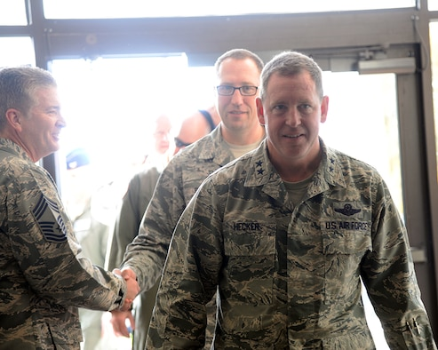 Maj. Gen. James Hecker, 19th Air Force commander, followed closely behind by Chief Master Sgt. Robert Boyer the 19th Air Force command chief, stop by the 149th Fighter Wing's Operations Group, Dec. 10, during his visit to Joint Base San Antonio-Lackland, Texas. Boyer accompanied the general on his site visit to the wing. During the visit, both Air Force leaders, toured several units and reacquainted themselves with the people and mission of the 149th FW.