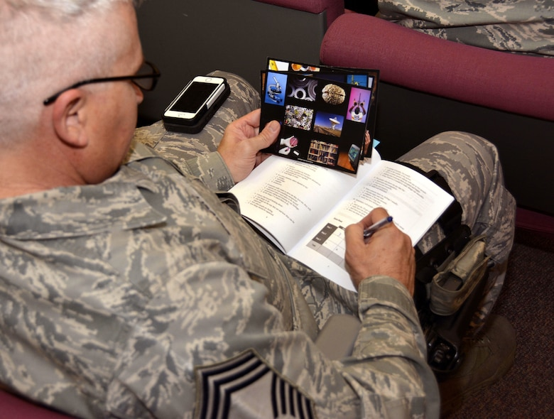 U.S. Air Force Chief Master Sgt. Brent Belcoff, manager of the 145th Security Forces Squadron, fills out his color chart during a Four Lenses & Enhanced Human Capital course held at the North Carolina Air National Guard Base, Charlotte Douglas International Airport, Dec. 11, 2015. More than 100 Airmen and Soldiers from the North Carolina National Guard attended the day-long professional development training where attendees learned better ways to communicate, not only as supervisors but strengthen communication and personal interaction with coworkers, family and friends. (U.S. Air National Guard photo by Master Sgt. Patricia F. Moran /Released)