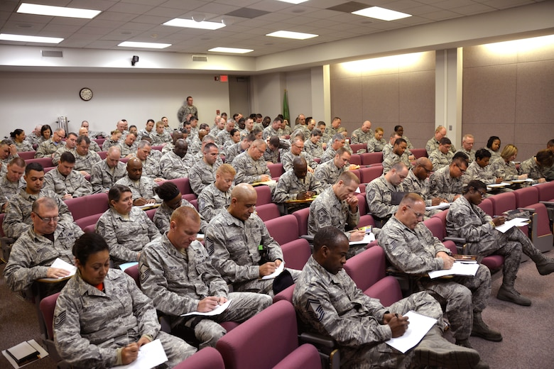 U.S. Air Force Airmen and Army Soldiers from the North Carolina National Guard write down all the roles they each fill in their lives as part of an exercise while attending a Four Lenses & Enhanced Human Capital course held at the North Carolina Air National Guard Base, Charlotte Douglas International Airport, Dec. 11, 2015. Attendees learned better ways to communicate, not only as supervisors but how to strengthen communication and personal interaction with coworkers, family and friends during the day-long professional development training. (U.S. Air National Guard photo by Master Sgt. Patricia F. Moran /Released)