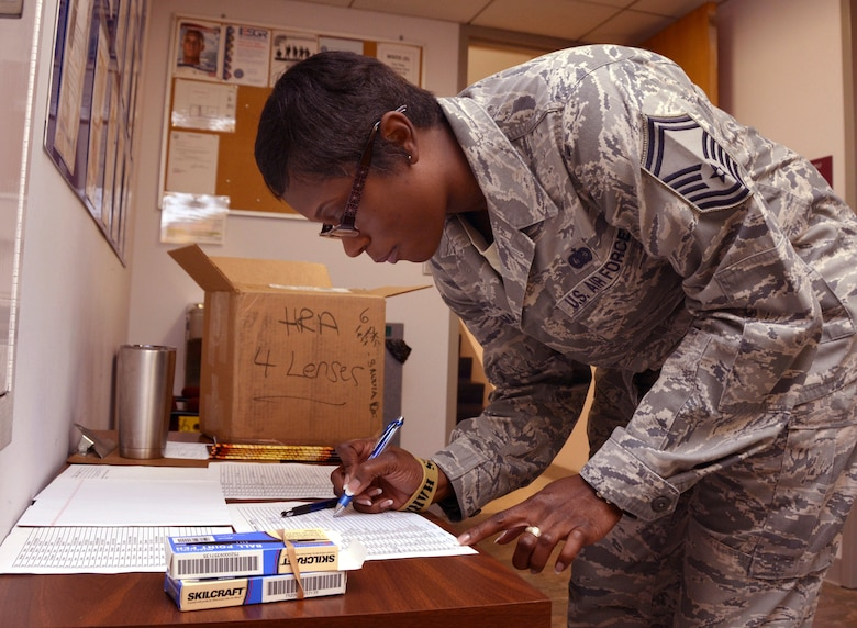 U.S. Air Force Senior Master Sgt. Martha L. Roman, 145th Airlift Wing, signs in prior to attending a Four Lenses & Enhanced Human Capital course held at the North Carolina Air National Guard Base, Charlotte Douglas International Airport, Dec. 11, 2015. More than 100 Airmen and Soldiers from the North Carolina National Guard attended the day-long professional development training where attendees learned better ways to communicate, not only as supervisors but strengthen communication and personal interaction with coworkers, family and friends. (U.S. Air National Guard photo by Master Sgt. Patricia F. Moran /Released)