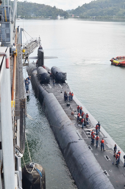 151114-N-VH871-121 SEPANGGAR, Malaysia (Nov. 14, 2015) The guided-missile submarine USS Ohio (SSGN 726) moors alongside the submarine tender USS Emory S. Land (AS 39). Emory S. Land's and Ohio's visit to Malaysia continues the U.S. Navy's ongoing commitment to theater security, cooperation and friendship with local partner navies. Emory S. Land is a forward deployed expeditionary submarine tender on an extended deployment conducting coordinated tended moorings and afloat maintenance in the U.S. 5th and 7th Fleet areas of operations. (U.S. Navy photo by Mass Communication Specialist Seaman Austin L. Ingram/Released)
