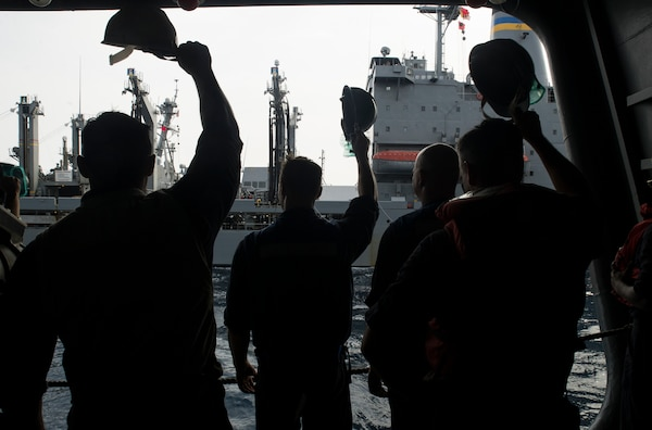 Sailors wave good-bye to the Military Sealift Command fleet replenishment oiler USNS Guadalupe after conducting a replenishment at sea with aircraft carrier USS George Washington. DLA delivered more than a million pounds of food to three South American countries for the GW to resupply during its voyage from San Diego to Norfolk, Virginia.