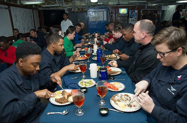 Sailors enjoy a meal during the October birthday celebration lunch aboard USS George Washington. DLA delivered more than a million pounds of food to three South American countries for the GW to resupply during its voyage from San Diego to Norfolk, Virginia.