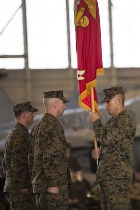 Lt. Col. Mathew A. Brown, left, takes command of Marine All-weather Fighter Attack Squadron 533 from Lt. Col. Alvin Bryant during a change of command ceremony aboard Marine Corps Air Station Beaufort Dec. 10. Sgt. Maj. Johnny R. Vancil holds the guidon in preparation for the change. Vancil is the sergeant major of VMFA(AW)-533.