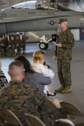 Lt. Col. Alvin Bryant speaks during a change of command ceremony aboard Marine Corps Air Station Beaufort Dec. 10. Bryant relinquished command of Marine All-Weather Fighter Attack Squadron 533 to Lt. Col. Mathew A. Brown.