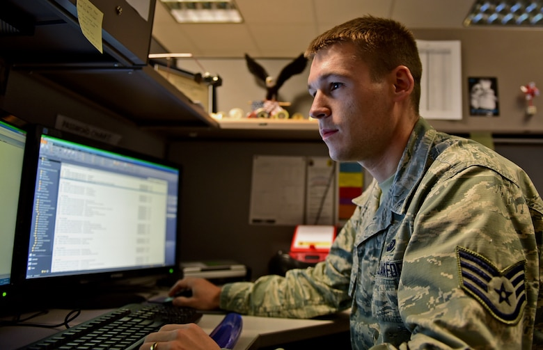 Air Force Staff Sgt. Chris Meyer, 28th Contracting Squadron contract administrator, reviews paperwork at Ellsworth Air Force Base, S.D., Nov. 4, 2015. One of Meyer's primary duties is reviewing contracts to ensure they comply with Air Force guidelines. U.S. Air Force photo by Airman 1st Class James L. Miller