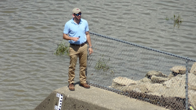 Risk cadre member Calvin Barefoot inspects spillway from an upstream training wall at the Town Bluff Dam in Texas for the Fort Worth District June 2013.