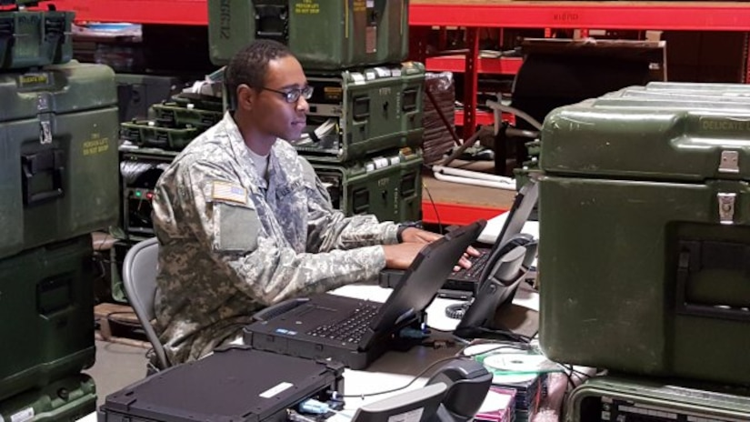 A Soldier, from the Army Reserve 392nd Expeditionary Signal Battalion, helps validate the unit's newly enhanced Warfighter Information Network-Tactical Increment 1 network equipment on Fort Eustis, Va., Nov. 30, 2015. (Photo Credit: Amy Walker, PEO C3T Public Affairs)