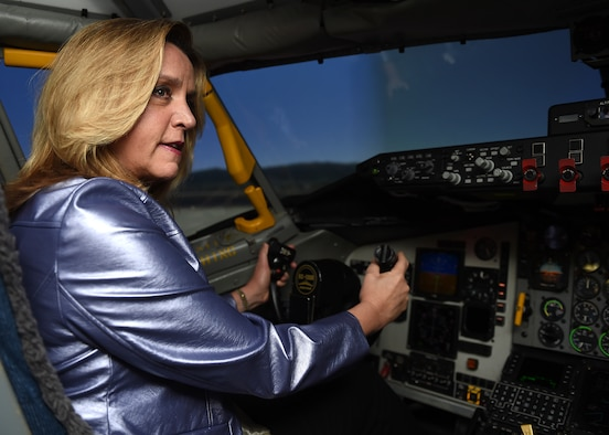 Secretary of the Air Force Deborah Lee James works the controls of a KC-135R Stratotanker simulator Dec. 16, 2015 during her visit to Grissom Air Reserve Base, Ind. During her visit she learned first-hand the mission and capabilities of the Hoosier Wing. (U.S. Air Force photo/Tech. Sgt. Benjamin Mota)