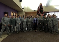 Airmen from the 434th Air Refueling Wing gather around Secretary of the Air Force Deborah Lee James following a luncheon Dec. 16, 2015 at Grissom Air Reserve Base, Ind. During her visit, Secretary James met with Airmen and learned first-hand the mission and capabilities of the Hoosier Wing. (U.S. Air Force photo/Capt. Cassandra Nelson)
