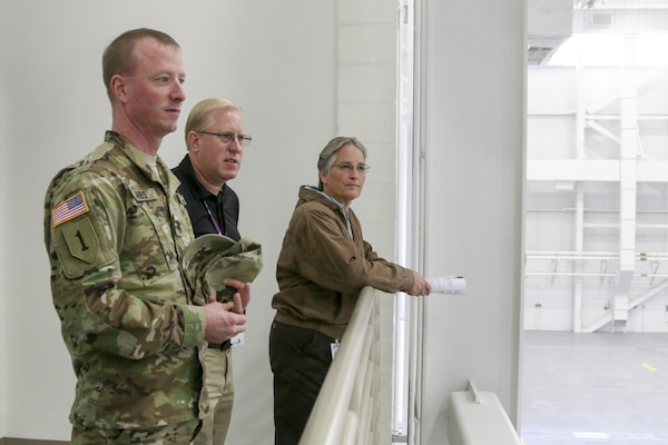 Troy Morris (center), project manager, briefs Col. Kirk Gibbs, commander of the U.S. Army Corps of Engineers Los Angeles District, at Davis-Monthan Air Force Base, Arizona, Dec. 7. Morris guided Gibbs and Shari Brandt, resident engineer for the Tucson Resident Office, through the newly completed 309th Aerospace Maintenance and Regeneration Group hangar, a 76,746-square-foot facility that features a two-story administration section housing a technical order library, records storage, tool cribs, equipment storage and an observation deck overlooking the hangar floor.