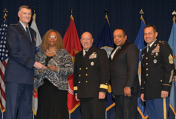 DLA Director Air Force Lt. Gen. Andy Busch presents the DLA Award for Achievement in equal employment opportunity by an employee to Debra Hobbs at the 48th Annual DLA Employee Recognition Ceremony Dec. 10 at the McNamara Headquarters Complex in Ft. Belvoir, Va. Pictured with Busch and Hobbs is Land and Maritime commander Navy Rear Adm. John King, Ferdinand LeCompte, DLA Equal Employment Opportunity director, and Army Command Sgt. Maj. Charles Tobin, DLA's senior enlisted leader.