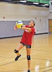 Spc. Deschelle Lincoln, aviation operations, Headquarters and Headquarters Company, 1st Combat Aviation Brigade, 1st Infantry Division, bumps the ball to a teammate during an Oct. 29 volleyball game at Fort Riley. Lincoln's team played three games to complete the night's match.