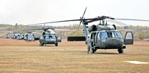 Five helicopters landed at the Douthit Gunnery Com¬plex carrying the Fort Leavenworth airmen from the Army Intermediate Level Education course Oct. 21 for a training session with Fort Riley Soldiers.