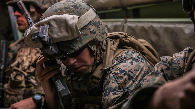 Corporal William Hastings, an intelligence analyst with Company E, 2nd Battalion, 4th Marine Regiment, 1st Marine Division, talks over the radio before deploying the Raven unmanned aerial system aboard Marine Corps Air Ground Combat Center, California, Dec. 10, 2015. The Marines employed the Raven UAS as part of Steel Knight to gain a better understanding of it and develop a higher proficiency as the ground combat element of the I Marine Expeditionary Force.