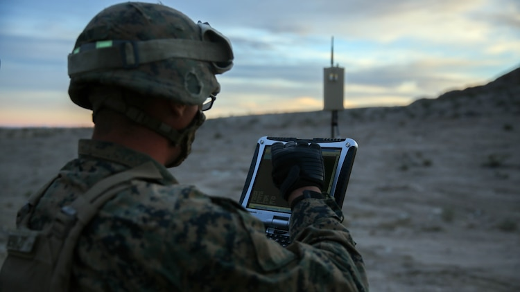 Lance Cpl. Travis DeShazo, a rifleman assigned to Company E, 2nd Battalion, 4th Marine Regiment, 1st Marine Division, prepares a computer to control a Raven unmanned aerial system to establish the location of notional enemy units aboard Marine Corps Air Ground Combat Center, California, Dec. 10, 2015. The Marines employed the Raven UAS as part of Steel Knight to gain a better understanding of it and develop a higher proficiency of what it takes to operate as a more effective as the ground combat element of the I Marine Expeditionary Force.