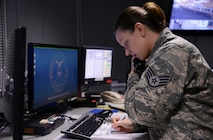 Staff Sgt. Erica Johnson, a 86th Airlift Wing command post senior emergency actions controller, takes a report Dec. 3, 2015, at Ramstein Air Base, Germany. The 86th AW command post is the largest reporting manager in U.S. Air Forces in Europe – Air Forces Africa supporting five wings, 12 groups, 57 squadrons, six bases and 39 geographically separated units. (U.S. Air Force photo/Airman 1st Class Tryphena  Mayhugh)