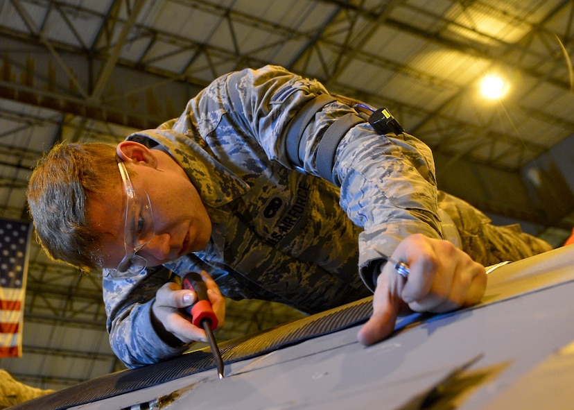Maintainers with the 436th Maintenance Squadron perform a major inspection on a C-5M Super Galaxy in the isochronal maintenance dock Dec. 2, 2015, at Dover Air Force Base, Del. (U.S. Air Force photo/Senior Airman William Johnson)