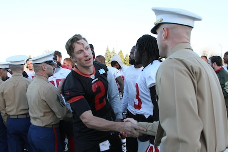 SANTA CLARA, Calif. - Major Jonathon Frerichs, the commanding officer of Recruiting Station San Francisco, meets Blaine Gabbert, the starting Quarterback of the San Francisco 49ers, during a visit to the team's facilities, Dec. 16, 2015. Staff Sergeant Rudy Castillo reaffirmed his commitment to the Marine Corps during a special ceremony after the 49ers' practice.