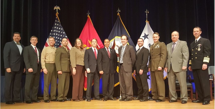 Members of Marine Corps Systems Command received the Innovation Excellence Acquisition Team of the Year award during a ceremony Nov. 17 at the Pentagon. (From left) James Smerchansky, MCSC executive director; Sean J. Stackley, assistant secretary of the Navy for Research, Development and Acquisition; Brig. Gen. Joseph Shrader, MCSC commander;  Capt. Jeramiah Lujan, Jane Bachman, John Raisbeck, Luis E. Velazquez, Tyson Kackley, Alexander Solomon, Maj James Reynolds, Mike O'Neal; and Adm. John Richardson, chief of Naval Operations. (U.S. Navy photo by Steven Vozzola)