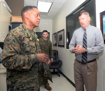 Fred Broome, director, Installation and Environmental Division, Marine Corps Logistics Base Albany, gives information to Maj. Gen. Craig C. Crenshaw, commanding general, Marine Corps Logistics Command, about the landfill gas generator during a tour, Dec. 16.