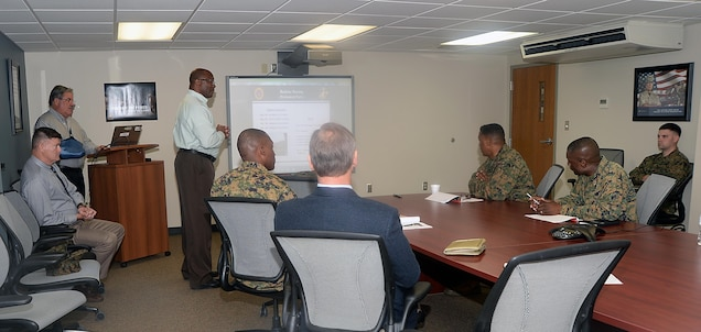 Randall Kennedy, housing officer, Marine Corps Logistics Base Albany, speaks about the base's bachelor housing during a brief on the installation, Dec. 16.