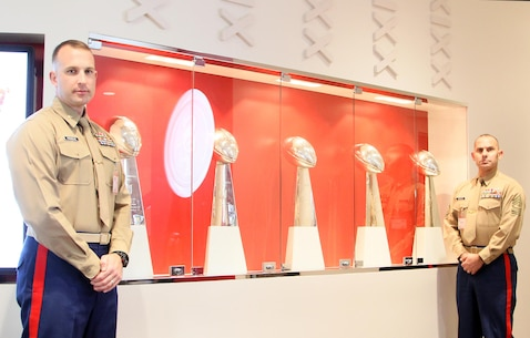 SANTA CLARA, Calif - Major Jonathon Frerichs, the commanding officer of Recruiting Station San Francisco, and Sgt. Maj. Larry Liechty, the RS San Francisco Sergeant Major, pose for a photo with the San Francisco 49ers Lombardi Trophies during a tour of the 49ers facilities here, Dec. 16, 2015. Staff Sergeant Rudy Castillo reaffirmed his commitment to the Marine Corps during a special ceremony after the tour.