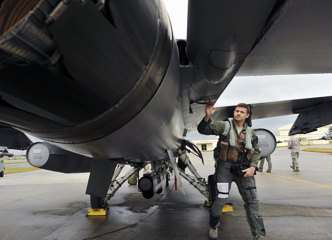 U.S. Air Force 1st Lt. Freddie Dee, 125th Expeditionary Fighter Squadron pilot, performs preflight checks on his F-16 Fighting Falcon before takeoff as part of a U.S. Pacific Command Theater Security Package Dec. 15, 2015, at Kadena Air Base, Japan. TSP deployments are designed to provide the U.S. Pacific Command with forces capable of a variety of operations, including disaster relief, global situational awareness, combating piracy, active defense and power projection. (U.S. Air Force photo by Naoto Anazawa)