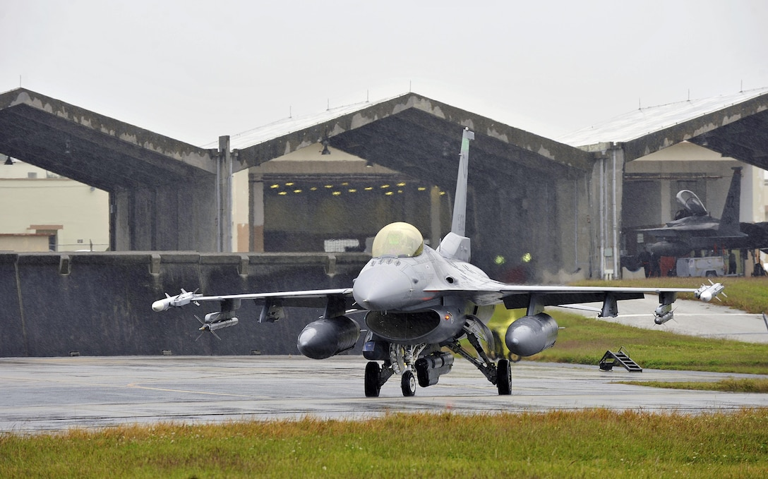 A U.S. Air Force F-16 Fighting Falcon from the 125th Expeditionary Fighter Squadron taxis for takeoff as part of the U.S. Pacific Command Theater Security Package Dec. 15, 2015, at Kadena Air Base, Japan. The 125th EFS, located at Tulsa Air National Guard Base, Okla, deployed to Kadena to provide PACOM with forces capable of a variety of operations including disaster relief, global situational awareness, combating piracy, active defense and power projection. (U.S. Air Force photo by Naoto Anazawa)