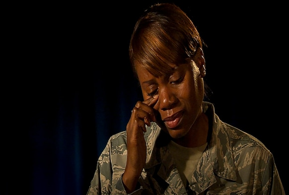 Master Sgt. Vickie Tippitt, a member of the 926th Force Support Squadron and the Nellis Air Force Base Yellow Ribbon representative, sheds a tear during an interview to discuss her rough childhood and how the Air Force saved her at Nellis Air Force Base, Nev., Oct. 20, 2015. Tippitt, who plans on sharing her story with the base populous Jan 21. as part of a new Storytellers program for the base, hopes to connect with other Airmen who might have went through the same struggles through their childhood. (Courtesy photo)
