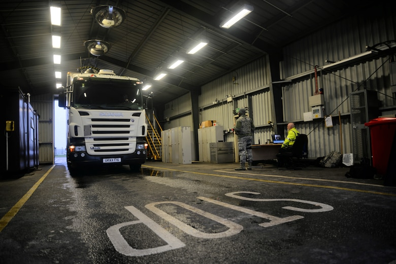 A truck enters the search barn for an inspection Dec. 15, 2015, on RAF Mildenhall, England. Airmen from the 100th Security Forces Squadron and Ministry of Defence Guard Service officers search vehicles for explosives, unauthorized people, contraband and illegal weapons. Both an armed Airman and a MGS civilian security officer are required to be in attendance during a vehicle inspection. (U.S. Air Force photo by Senior Airman Christine Halan/Released)