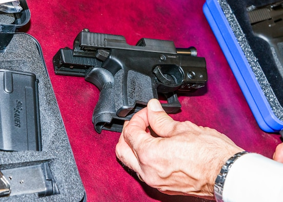 A Sig Sauer P290RS, above, and a Glock 43 were two of 10 weapons on display Dec. 10 at Air Force Office of Special Investigations headquarters to showcase some of the options available to Special Agents who want to carry a privately owned weapon in accordance with new OSI Weapons Program policy guidance. (U.S. Air Force photo by Michael Hastings)