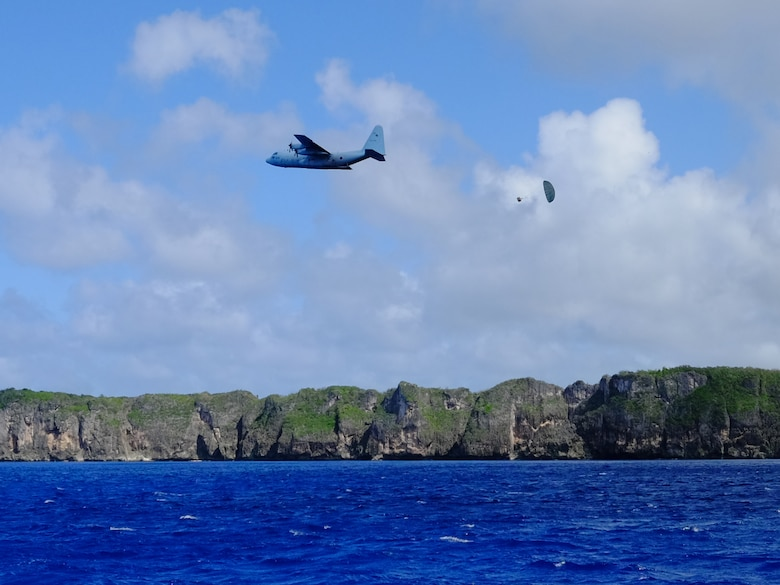 A Japan Air Self-Defense Force C-130H executes a low-cost, low-altitude bundle drop as part of Operation Christmas 2015, Dec. 7, 2015. This year marks the first ever trilateral Operation Christmas Drop where the U.S. Air Force, JASDF and the Royal Australian Air Force work together to provide critical supplies to 56 Micronesian islands while executing partner Humanitarian Aid/Disaster Relief training. (U.S. Air Force photo by Master Sgt. Christopher Bergstrom)