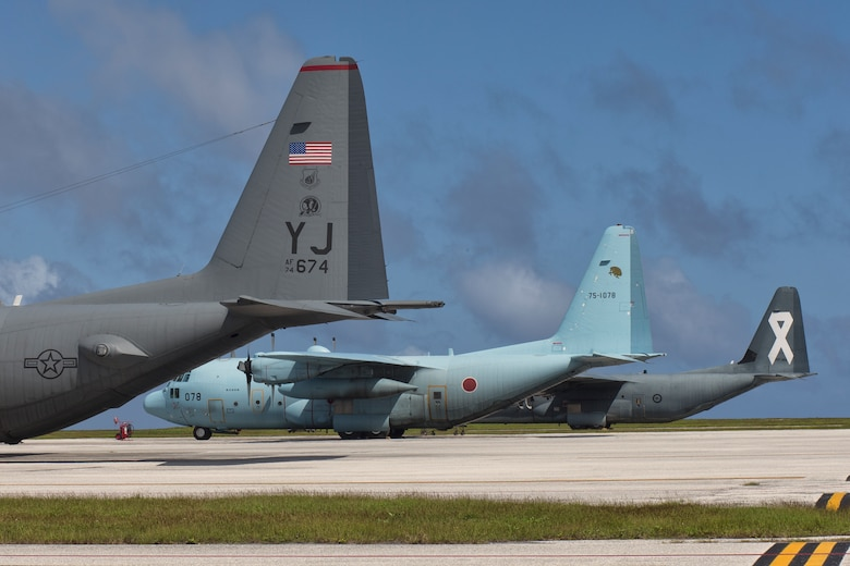 C-130s from the U.S. Air Force, Japan Air Self-Defense Force and Royal Australian Air Force park on the ramp at Andersen Air Force Base, Dec. 6, 2015 in preparation for Operation Christmas Drop. This year marks the 64th year of Operation Christmas Drop, and the first trilateral execution of Department of Defense's longest running humanitarian airdrop mission. (U.S. Air Force photo by Osakabe Yasuo/Released)