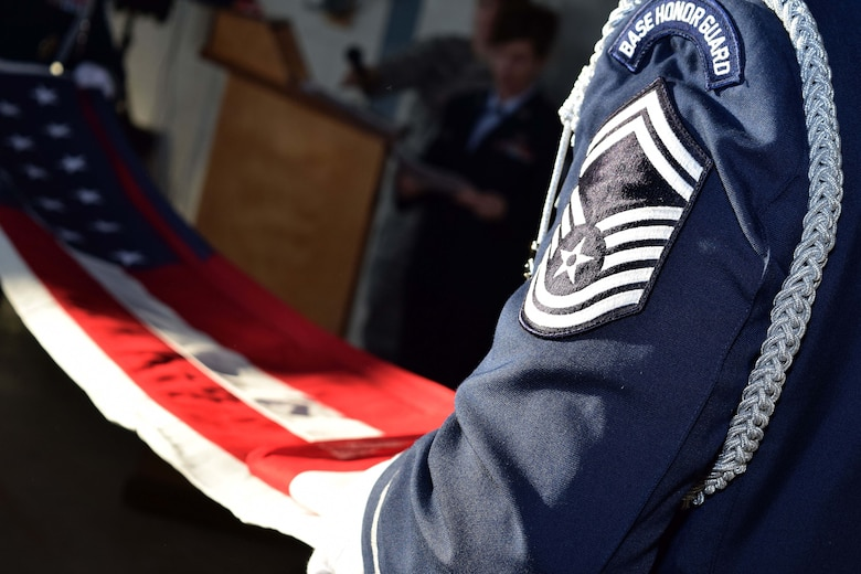Members of the 111th Attack Wing Honor methodically fold the American flag during a retirement ceremony for Chief Master Sgt. Stephen Rossi, vehicle maintenance superintendent with the 201st RED HORSE, Det. 1, at the Horsham Air Guard Station, Pennsylvania, Dec. 5, 2015. Rossi was presented the flag as he prepares to retire from the Wing after nearly four decades of service to the Pennsylvania National Guard. (U.S. Air National Guard photo by Master Sgt. Christopher Botzum/Released)