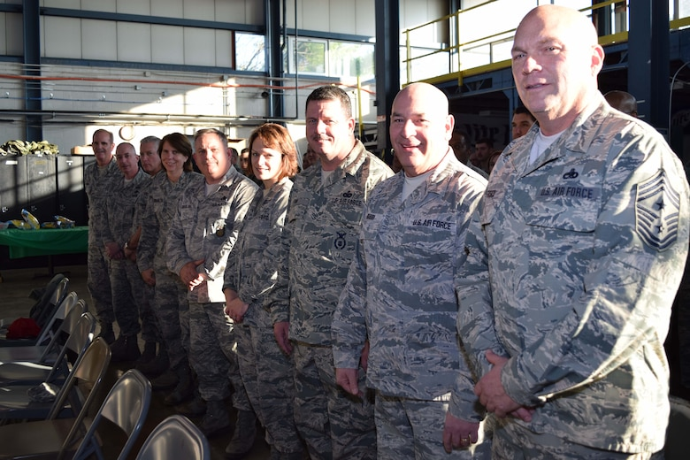 A tribe of chiefs from the 111th Attack Wing gather to honor retiring Chief Master Sgt. Stephen Rossi, vehicle maintenance superintendent with the 201st RED HORSE, Det. 1, at the Horsham Air Guard Station, Pennsylvania, on Dec. 5, 2015. Rossi is closing out his lengthy military career having served with the Pennsylvania Army National Guard for 21 years followed by an additional 18 years with the Pennsylvania Air National Guard here. (U.S. Air National Guard photo by Master Sgt. Christopher Botzum/Released)