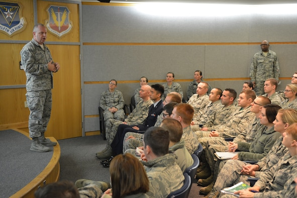 Chief Master Sgt. James W. Hotaling, Air National Guard command chief, speaks to Airmen of the 115th Fighter Wing in Madison, Wis., Dec. 6, 2015. He met with squadron commanders, Airmen of the Rising 6 and the senior enlisted members of the Top 3 to talk about various topics relating to Airmen of the ANG. (U.S. Air National Guard photo by Senior Airman Kyle P. Russell)