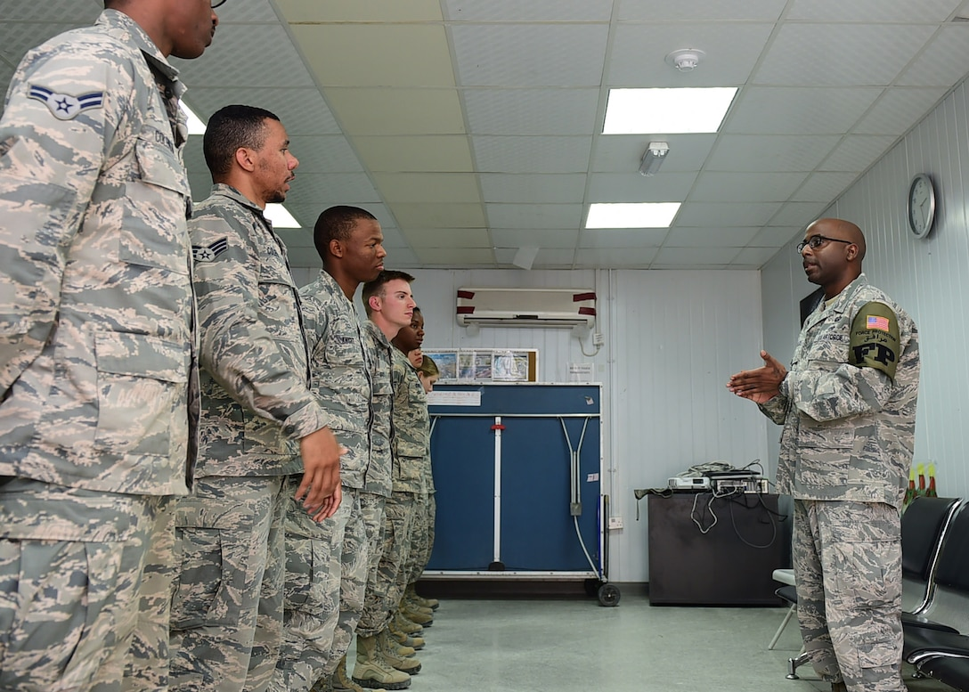 Tech. Sgt. Tyron Fields, a 386th Expeditionary Civil Engineer Squadron Force Protection shift lead, speaks to Airmen during roll call at an undisclosed location in Southwest Asia, Dec. 16, 2015. Fields co-founded a mentorship program aimed to help troubled youth in his hometown of Charleston, South Carolina. Fields is currently deployed to the 386th AEW in support of Operation INHERENT RESOVE. (U.S. Air Force photo by Staff Sgt. Jerilyn Quintanilla)