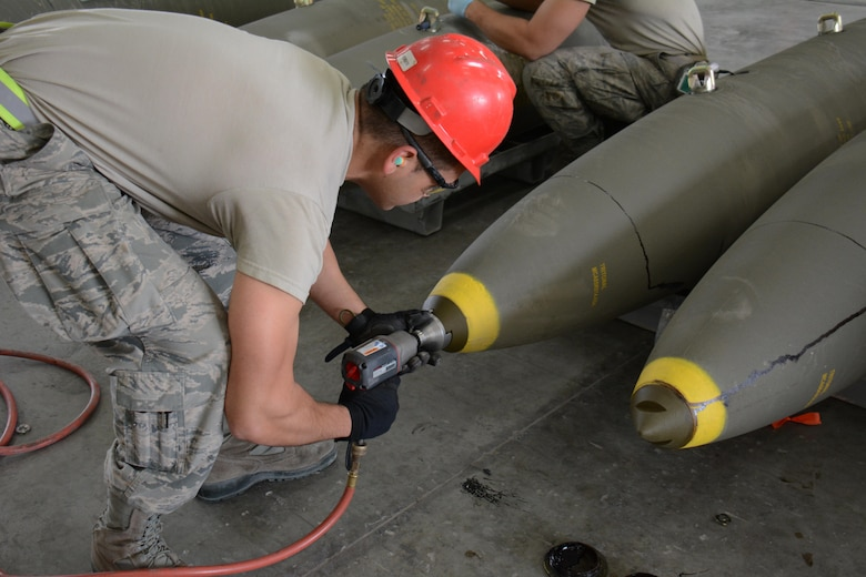 Airman 1st Class Ralph Pangilinan, 379th Expeditionary Maintenance Squadron Munitions Flight, prepares a joint attack direct munition for transport at Al Udeid Air Base, Qatar Dec. 17. Pangilinan, a native of San Diego, California, is a part of a record-setting munitions team that has built nearly 4,000 bombs since July 2015. (U.S. Air Force photo by Tech. Sgt. James Hodgman/Released)