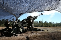 Marines with Charlie Battery, 1st Battalion, 10th Marine Regiment, fire an M777A2 howitzer during a gunnery precision and calibration exercise at Camp Lejeune, N.C., Dec. 15, 2015. The M777A2 has an unassisted range of 15 miles. The Marines conducted the training to solidify team cohesion and enhance their readiness to complete live-fire missions in preparation for Exercise Cold Response 16. Cold Response 16 is a multinational, Norwegian-led exercise that prepares more than 15,000 troops from 16 countries for support and combat operations in harsh conditions while working together to create stronger bonds between the allied forces.  (U.S. Marine Corps photo by Lance Cpl. Shannon Kroening/Released)