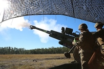 Marines with Charlie Battery, 1st Battalion, 10th Marine Regiment, fire the first round of the day out of an M777A2 howitzer, during a gunnery precision and calibration exercise at Camp Lejeune, N.C., Dec. 15, 2015. The Marines conducted the training to solidify team cohesion and enhance their readiness to complete live-fire missions in preparation for Exercise Cold Response 16. Cold Response 16 is a multinational, Norwegian-led exercise that prepares more than 15,000 troops from 16 countries for support and combat operations in harsh conditions while working together to create stronger bonds between the allied forces.  (U.S. Marine Corps photo by Lance Cpl. Shannon Kroening/Released)