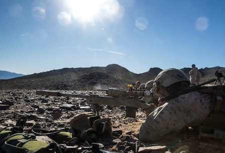 Marines with 1st Battalion, 8th Marine Regiment await for the command to engage man-size targets during the sniper marksmanship assessment as part of Integrated Training Exercise 1-16 aboard Marine Air Ground Combat Center, Twentynine Palms, Calif., Oct. 24, 2015. During ITX, Marines demonstrate core infantry mission essential tasks while conducting offensive and defensive stability operations. (U.S. Marine Corps photo by Cpl. Immanuel M. Johnson/Released)