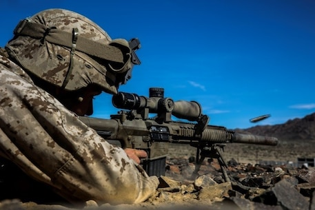 A Marine with 1st Battalion, 8th Marine Regiment fires at a target at an unknown distance drill during the sniper marksmanship assessment as part of Integrated Training Exercise 1-16 aboard Marine Air Ground Combat Center, Twentynine Palms, Calif., Oct. 24, 2015. During ITX, Marines demonstrate core infantry mission essential tasks while conducting offensive and defensive stability operations. (U.S. Marine Corps photo by Cpl. Immanuel M. Johnson/Released)